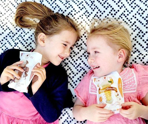 Two girls enjoying milk